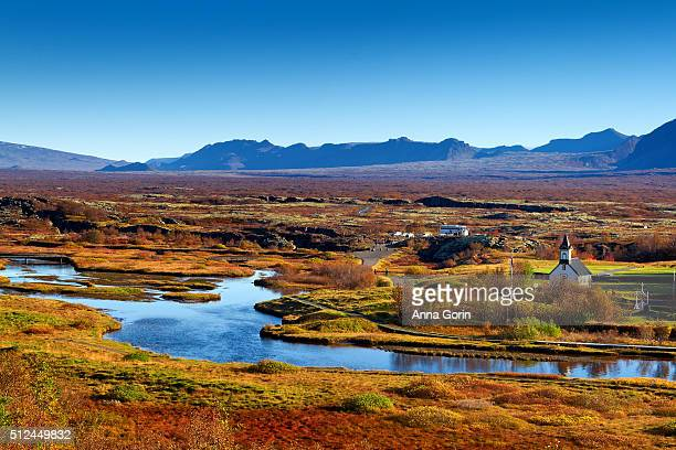 thingvallakirkja church along banks of oxara river in thingvellir national park, iceland, autumn afternoon - pingvellir national park stock photos and pictures