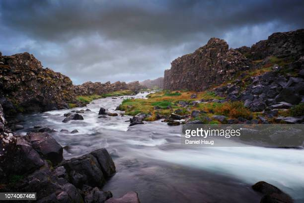 thingvellir national park under moody overcast skies - where the eurasian and north american tectonic plates meet and are exposed to the icelandic air - tectonic stock photos and pictures