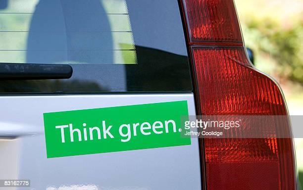think green bumper sticker on car - bumper sticker stock photos and pictures