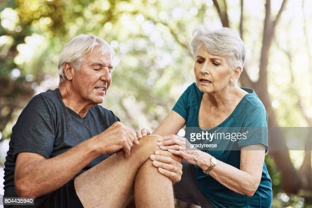 i think it could be sprained - knees together stock photos and pictures