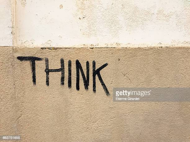 Think text on building wall