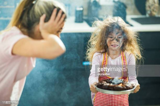 i think the cake was baked a little longer than it should, mommy! - failure stock pictures, royalty-free photos & images