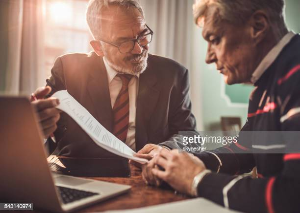 i think you'll be pleased with this deal offer! - banker stock photos and pictures