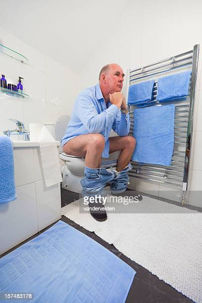 thinker in blue and white - men taking a dump stock pictures, royalty-free photos & images