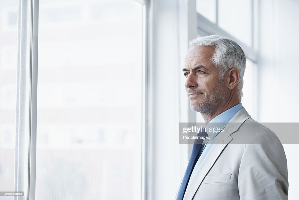 Thinking about his business future : Stock Photo