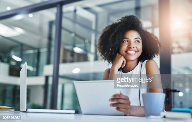 thinking about how to take the business to technological heights - toothy smile stock pictures, royalty-free photos & images