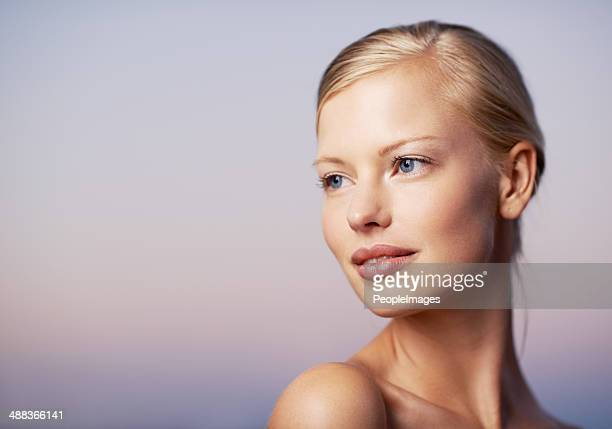 thinking about new beauty techniques - cheek stock pictures, royalty-free photos & images