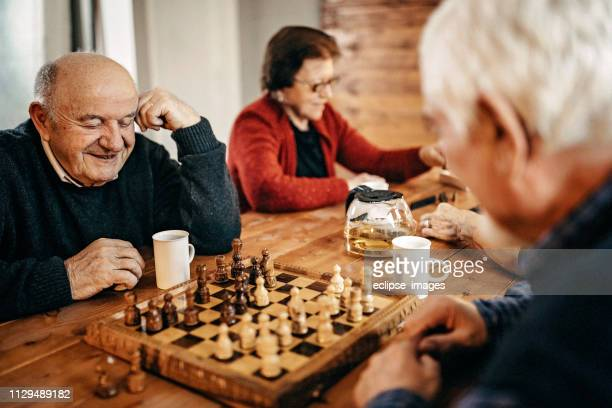 thinking about next move - chess stock pictures, royalty-free photos & images