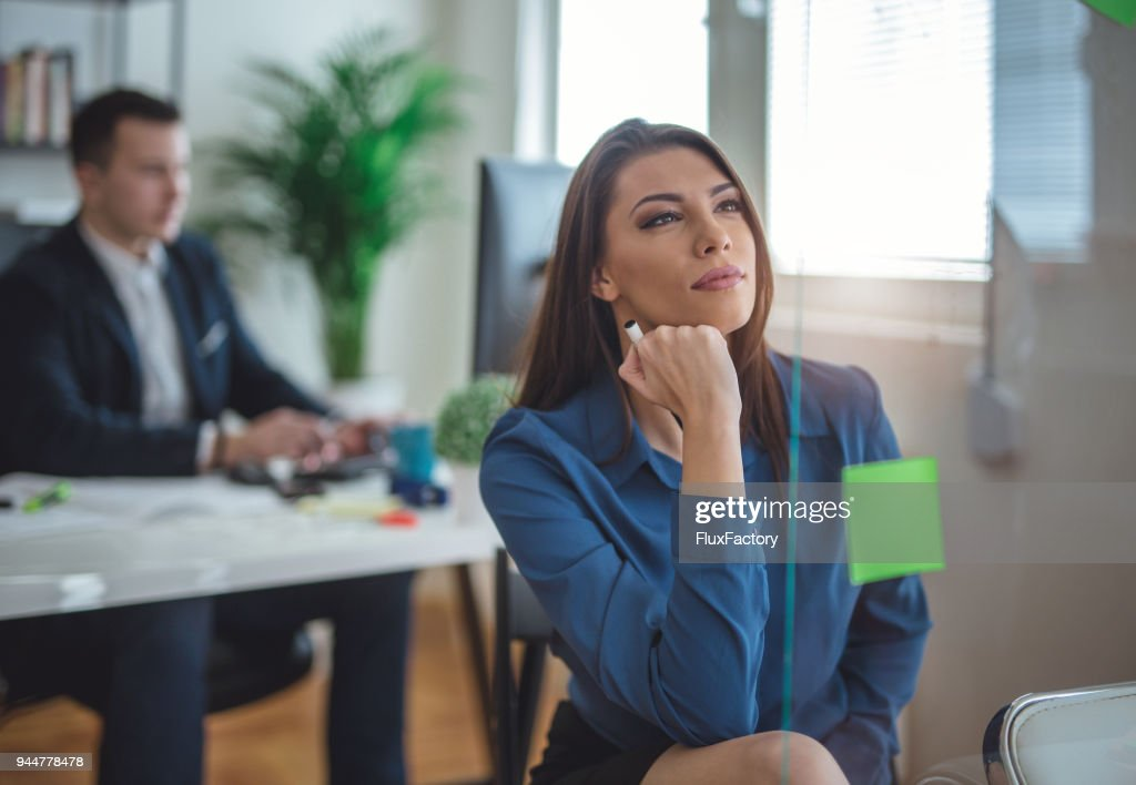 Thinking about the work that must be done : Stock Photo