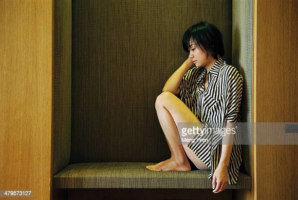 Thinking girl portrait in the corner