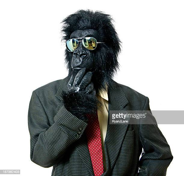 thinking gorilla business man - animal costume stock pictures, royalty-free photos & images