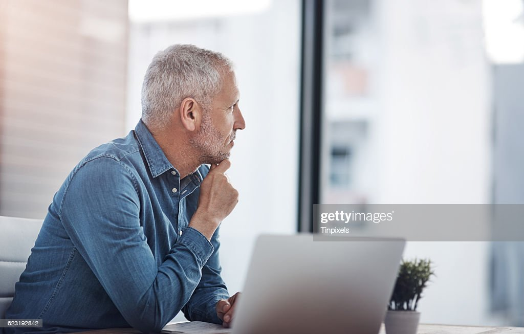 Thinking of ways to transform his ideas into successful results : Stock Photo