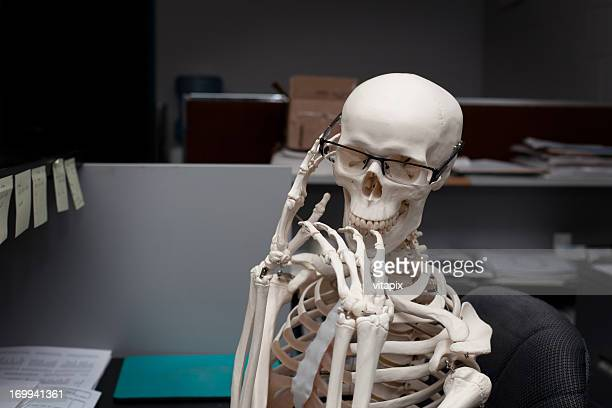 thinking skeleton at work - human skeleton stock photos and pictures
