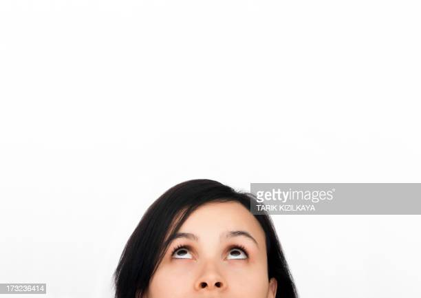 Thinking woman in front of whiteboard
