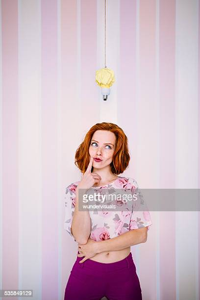 Thinking Woman With Lightbulb Above Head