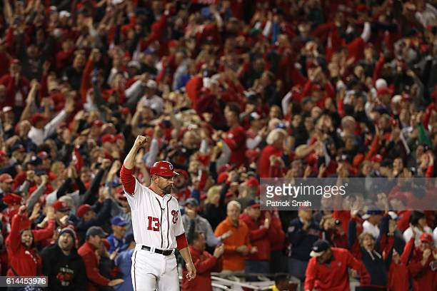 Third base coach Bob Henley of the Washington Nationals celebrates after Chris Heisey hit a two run home run in the seventh inning against the Los...