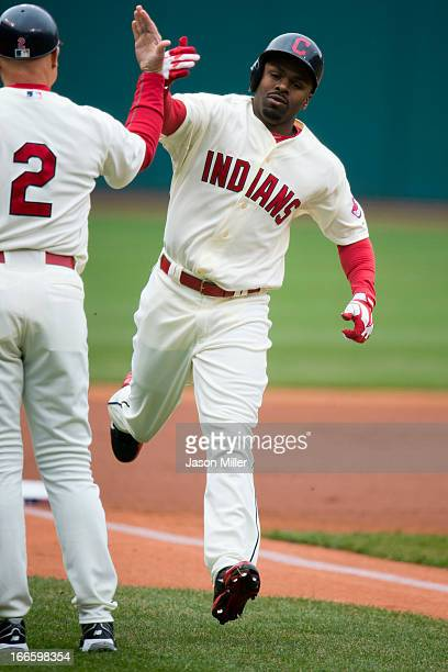Third base coach Brad Mills celebrates with Michael Bourn of the Cleveland Indians after Bourn hit a solo home run against the Chicago White Sox...