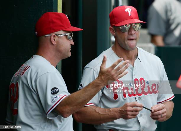 Third base coach Dusty Wathan and manager Gabe Kapler of the Philadelphia Phillies talk during the ninth inning of a game against the Detroit Tigers...