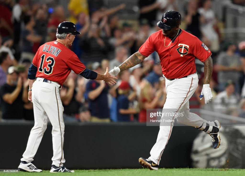 Third base coach Gene Glynn #13 of the Minnesota Twins congratulates Kennys Vargas #19 on a three-run home run against the San Diego Padres during the seventh inning of the game on September 12, 2017 at Target Field in Minneapolis, Minnesota. The Twins defeated the Padres 16-0.