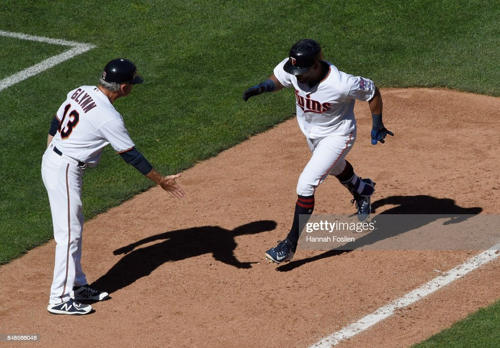 Third base coach Gene Glynn #13 of the Minnesota Twins congratulates Eddie Rosario #20 on a solo home run against the Toronto Blue Jays during the fifth inning of the game on September 17, 2017 at Target Field in Minneapolis, Minnesota. The Twins defeated the Blue Jays 13-7.
