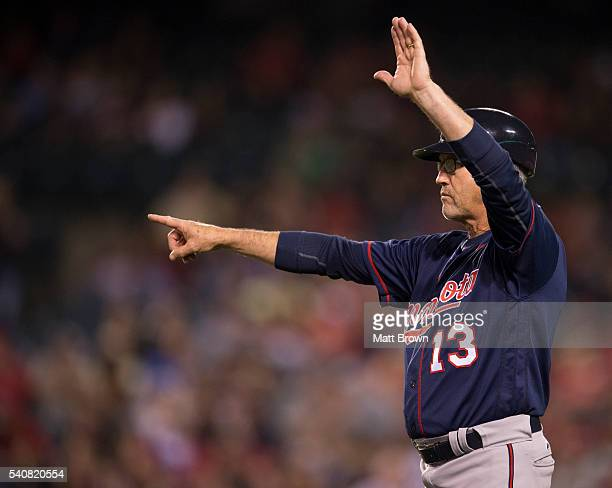 Third base coach Gene Glynn of the Minnesota Twins signals during the seventh inning of the game against the Los Angeles Angels of Anaheim at Angel...