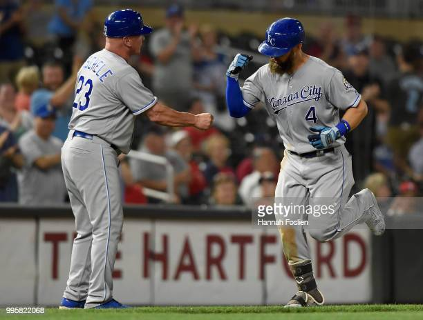 Third base coach Mike Jirschele of the Kansas City Royals congratulates Alex Gordon on a tworun home run against the Minnesota Twins as he rounds the...