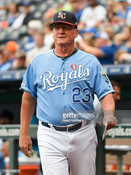 Third base coach Mike Jirschele of the Kansas City Royals heads to the base during the first inning of their game against the Cleveland Indians at...