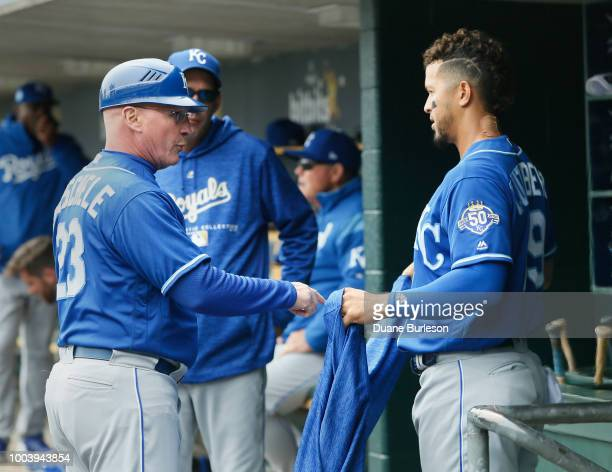 Third base coach Mike Jirschele of the Kansas City Royals talks with Cheslor Cuthbert of the Kansas City Royals during a game against the Detroit...