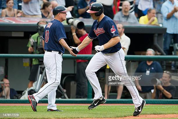 Third base coach third base coach Steve Smith celebrates with Shelley Duncan of the Cleveland Indians after Duncan hit a solo home run during the...