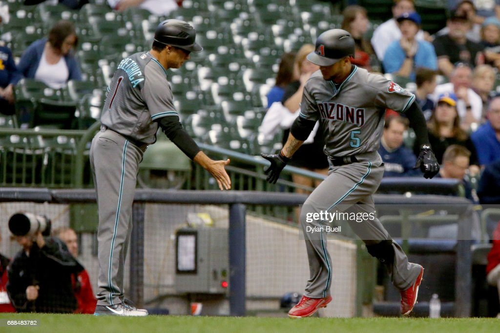 Third base coach Tony Perezchica of the Arizona Diamondbacks congratulates Gregor Blanco #5 after hitting a home run in the first inning against the Milwaukee Brewers at Miller Park on May 25, 2017 in Milwaukee, Wisconsin.