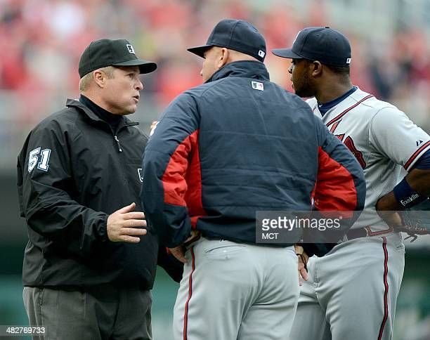 Third base umpire Marvin Hudson speaks with Atlanta Braves manager Fredi Gonzalez center and Braves right fielder Jason Heyward after a ball hit by...
