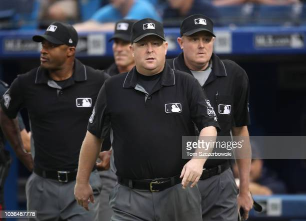 Third base umpire Todd Tichenor walks out onto the field with fellow umpires first base umpire Alan Porter and second base umpire Angel Hernandez and...