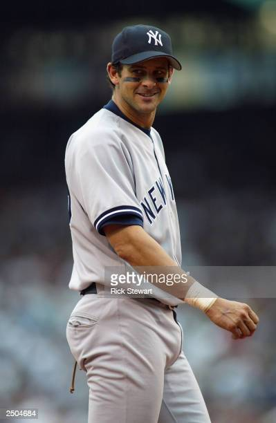 Third baseman Aaron Boone of the New York Yankees walks on the field during the game against the Boston Red Sox at Fenway Park on August 30 2003 in...