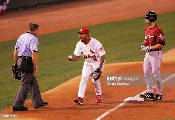 Third baseman Abraham Nunez of the St Louis Cardinals argues third base umpire Larry Poncino missing a tag on a triple by Chris Burke of the Houston...