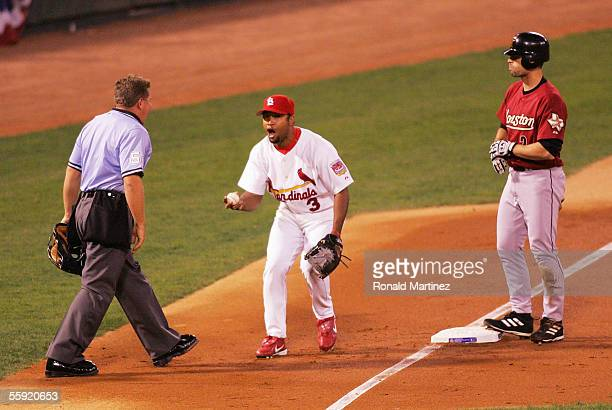 Third baseman Abraham Nunez of the St Louis Cardinals argues with third base umpire Larry Poncino after missing a tag on a triple by Chris Burke of...
