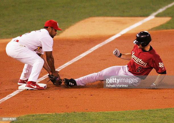 Third baseman Abraham Nunez of the St Louis Cardinals misses a tag on a triple by Chris Burke of the Houston Astros in Game Two of the 2005 National...