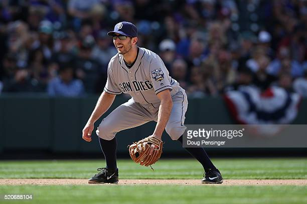Third baseman Adam Rosales of the San Diego Padres plays defense against the Colorado Rockies at Coors Field on April 10 2016 in Denver Colorado The...
