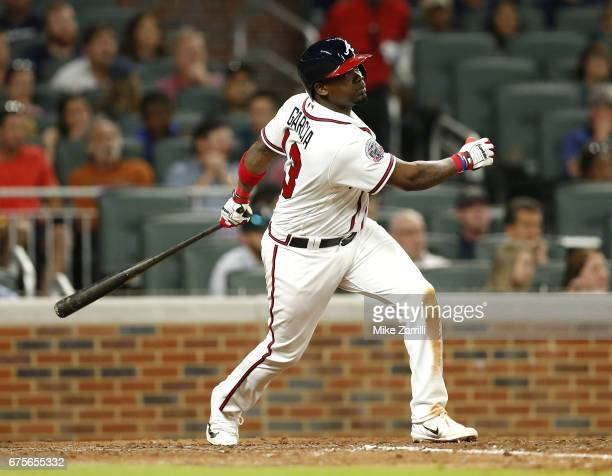 Third baseman Adonis Garcia of the Atlanta Braves hits a sacrifice fly in the sixth inning during the game against the New York Mets at SunTrust Park...