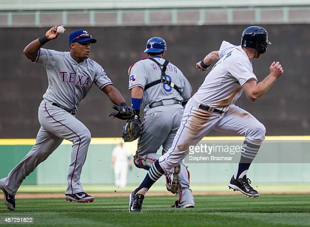 Third baseman Adrian Beltre of the Texas Rangers catches Brad Miller of the Seattle Mariners in a rundown during the fifth inning of a gamge at...