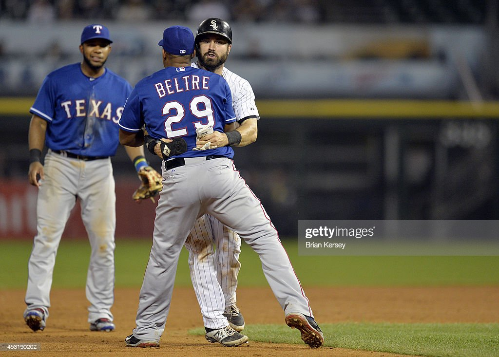 Third baseman Adrian Beltre #29 of the Texas Rangers hugs Adam Eaton #1 of the Chicago White Sox after Eaton was caught in a rundown while trying to steal third base during the fifth inning at U.S. Cellular Field on August 4, 2014 in Chicago, Illinois.