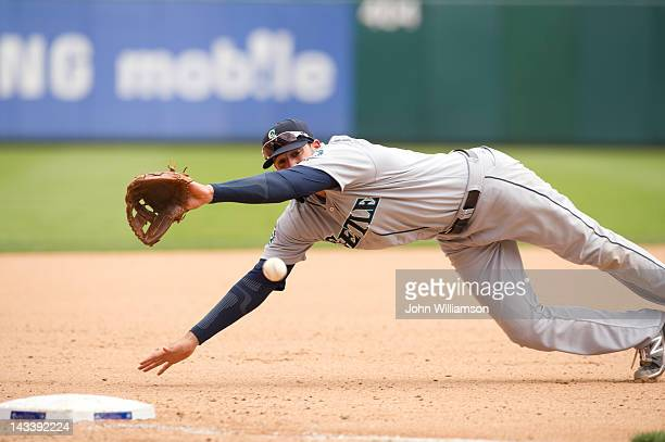Third baseman Alex Liddi of the Seattle Mariners dives for a ground ball in the game against the Texas Rangers on Thursday April 12 2012 at Rangers...