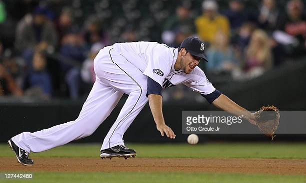 Third baseman Alex Liddi of the Seattle Mariners dives for a single off the bat of Brandon Allen of the Oakland Athletics at Safeco Field on...