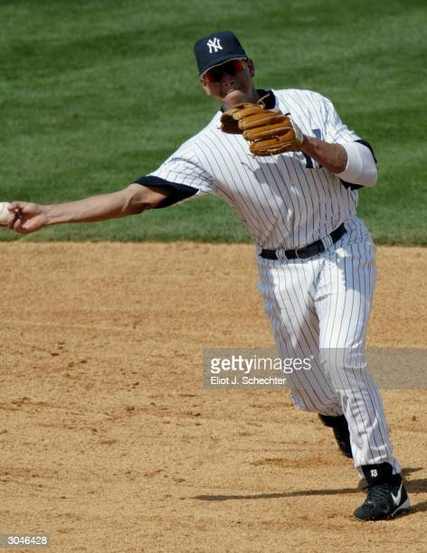 Third baseman Alex Rodriguez of the New York Yankees fields a ball against the Philadelphia Phillies during Spring Training March 5 2004 at Legends...