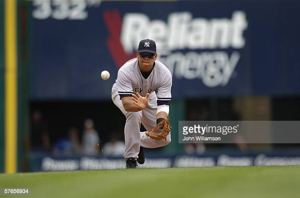 Third baseman Alex Rodriguez of the New York Yankees fields a ground ball during the game against the Texas Rangers at Ameriquest Field in Arlington...