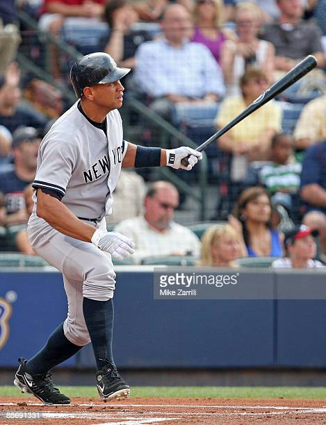 Third baseman Alex Rodriguez of the New York Yankees follows through and watches his home run in the first inning during the game against the Atlanta...