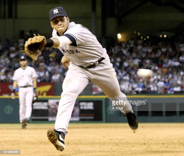 Third Baseman Alex Rodriguez of the New York Yankees just misses a two base hit off the bat of Alfonso Soriano of the Texas Rangers at Ameriquest...