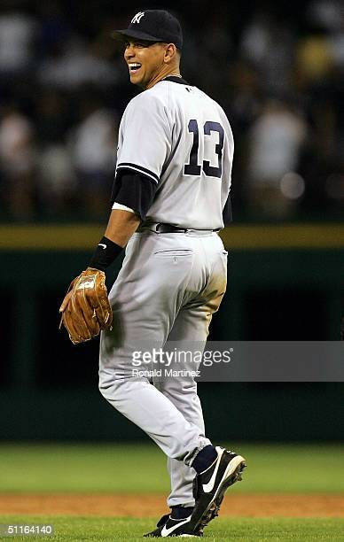 Third baseman Alex Rodriguez of the New York Yankees laughs after a 51 win against the Texas Rangers on August 12 2004 at Ameriquest Field in...