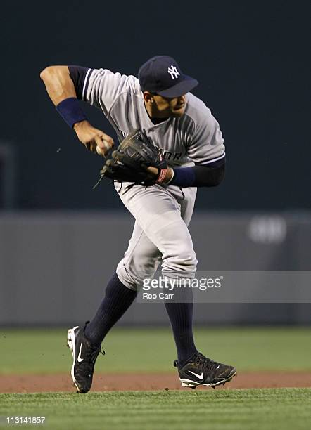 Third baseman Alex Rodriguez of the New York Yankees makes a play against the Baltimore Orioles at Oriole Park at Camden Yards on April 23 2011 in...