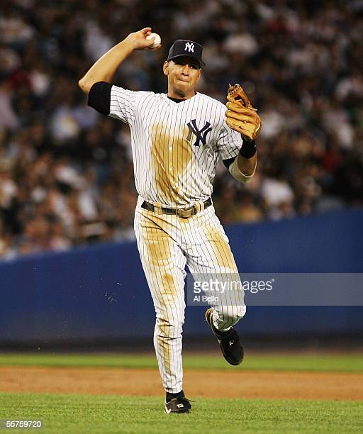 Third baseman Alex Rodriguez of the New York Yankees makes a play to first base in the eighth inning against the Toronto Blue Jays on September 23,...