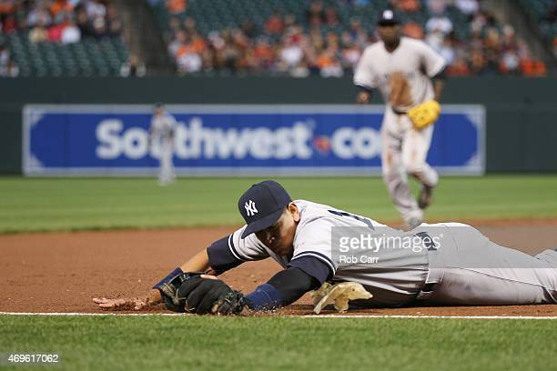 Third baseman Alex Rodriguez of the New York Yankees misses a ball hit by Adam Jones of the Baltimore Orioles for a single in the third inning at...